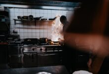 Why do restaurants need to clean the hood in their kitchen?
